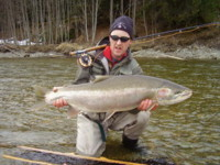 Gord McKean with a huge Steelhead landed while fly fishing