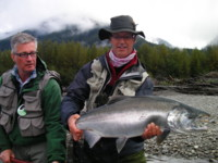 Guests of Westcoast Fishing Adventures with bright Coho Salmon